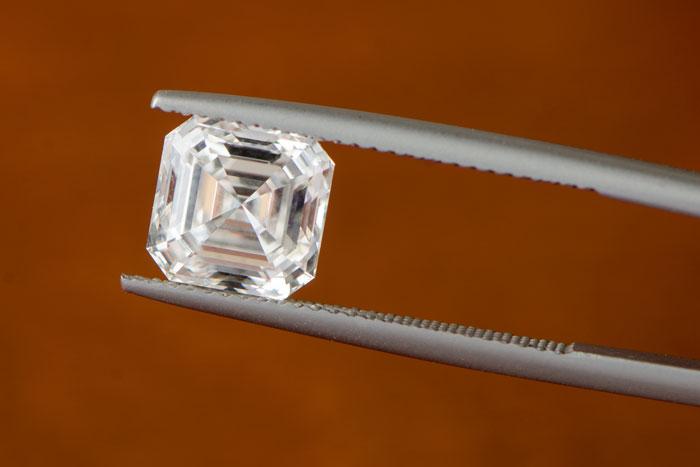 Asscher Cut Diamond on Tweezers